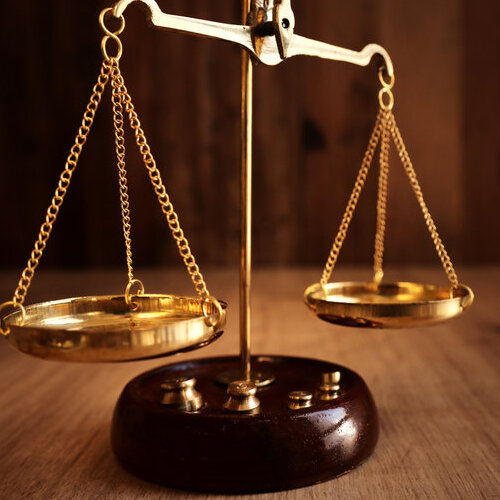Law scales on a wooden table.